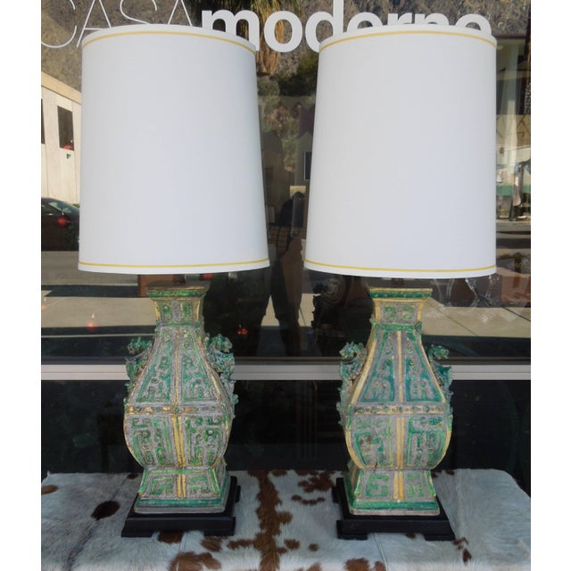 From a very prominent Palm Springs Estate, a pair of rare vintage gorgeous chinoiserie ceramic lamps. Butter yellow,...