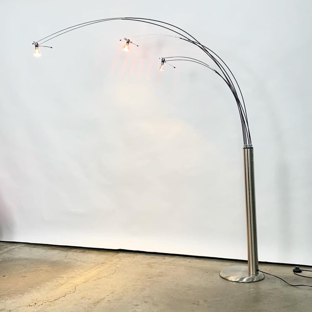 This cool modern Italian floor lamp has a heavy metal base with 6 wires the project out to create an arc shape. These are...