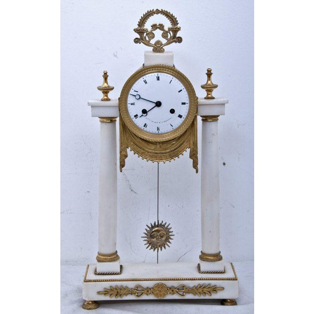 A 19th Century Louis XVI style French marble mantel clock with gilt bronze mounts.