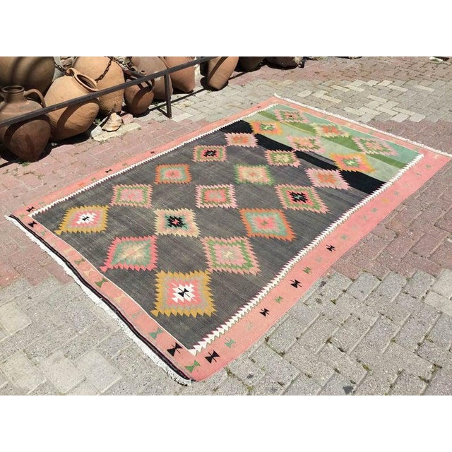 This gorgeous vintage Turkish kilim rug was made of wool in 1960`s. It`s professionally cleaned and ready to be a...