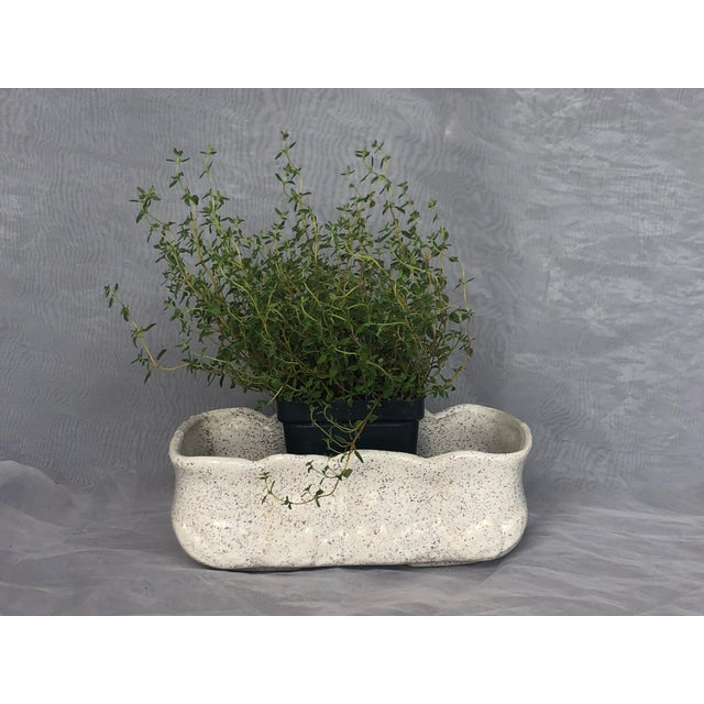 Fill this vintage mid-century pottery planter with small house plants for a modern organic decor look. The stylish indoor...