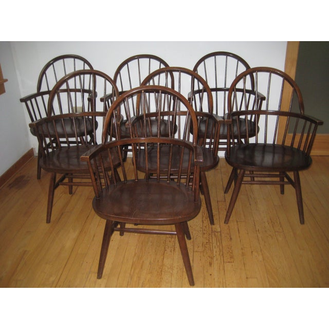 These seven Windsor style chairs have a rich dark walnut finish. A classic design made by the Boling Chair Company in...