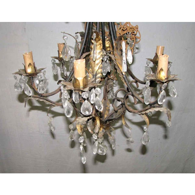 Vintage six light chandelier with foliage motif and crystals.