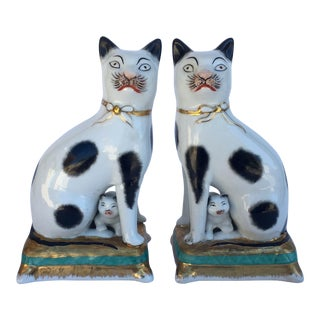 English Porcelain Staffordshire Cats Seated on Pillow Tufts - A Pair For Sale