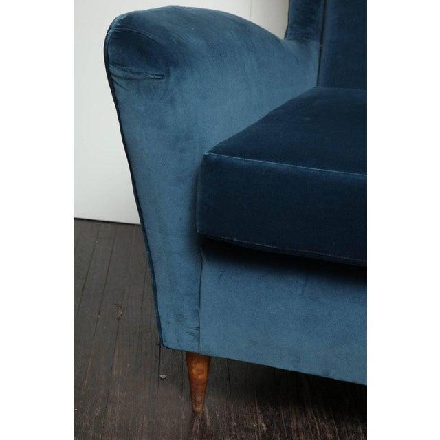 Vintage Italian modern wingback chairs in blue velvet.