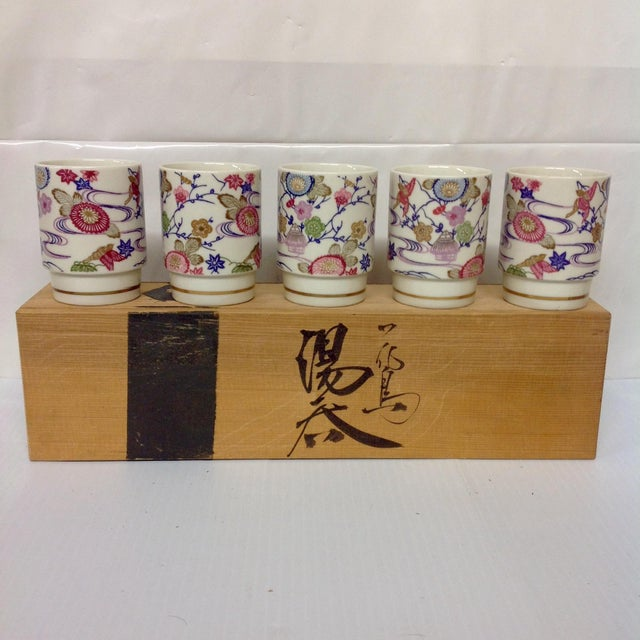 """Set of Hand Painted Japanese Porcelain Cups. Includes all pieces shown and original signed box. Each cup measures 2.5""""..."""