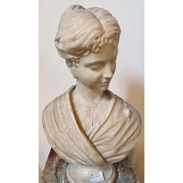Alabaster bust of young lady and a bird, 19th-20th century. This is simply the sweetest little girl looking off to her...