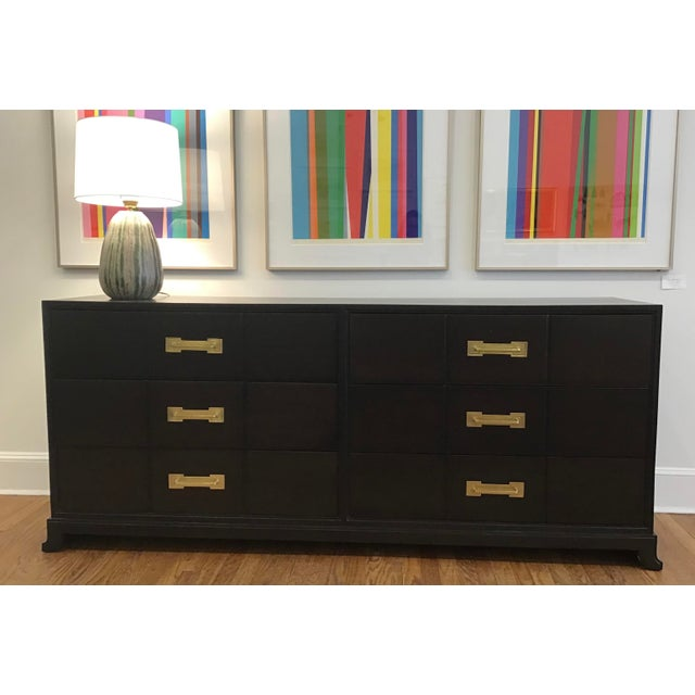 Six drawer chest designed by Tommi Parzinger for Charak Furniture Company. This cabinet was refinished in an ebony stain...