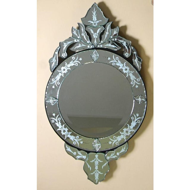 Vintage Venetian Italian wall mirror with reverse etched decoration. Circular central mirror with vertical decoration.