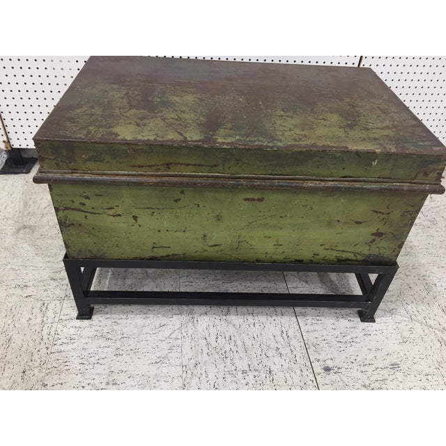 Antique English military metal trunk with brass latch on custom iron base.