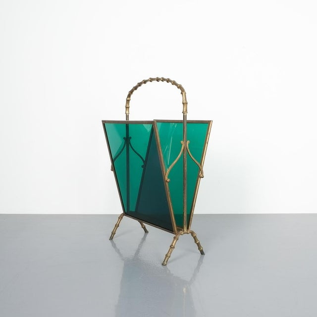 Maison Baguès faux bamboo green Lucite magazine rack. Delicate magazine rack comprised of brass and green Lucite panels....