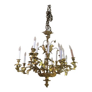 French Rococo Style Relief Cast Gilt Bronze 16-Light Chandelier For Sale