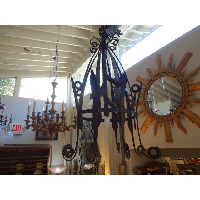 Highly unusual early 20th century French hand forged wrought iron lantern. This large lantern has beautiful detail and...