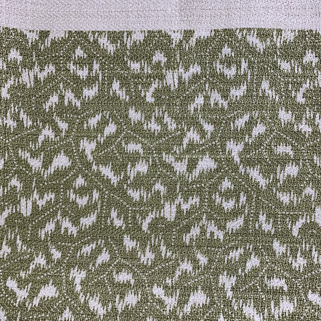 Classic linen textile from Penny Morrison. Handprinted in the UK, a hand print in a moss green. Pattern is called...