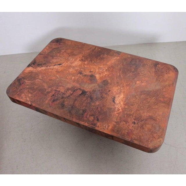 Huge coffee table with copper tabletop and mahogany base by Bernard Rohne. The table is from the 1960s and it's in a very...