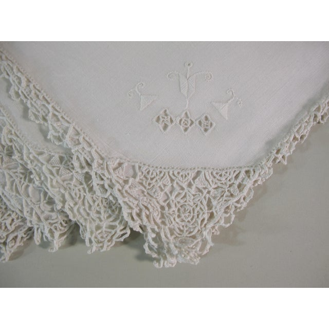 A set of 4 hand-embroidered linen napkins with a hand-crocheted edge. Starched and pressed.