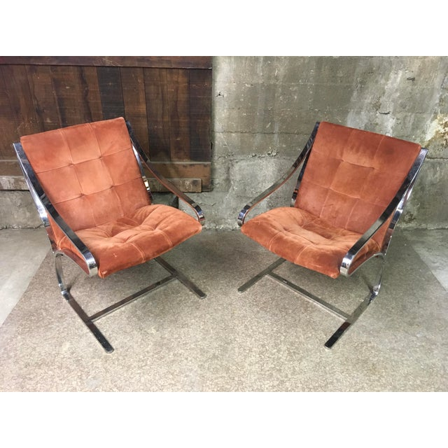 Fantastic pair of hefty flat bar polished steel frame cantilevered lounge chairs designed by Bert England for Brueton....