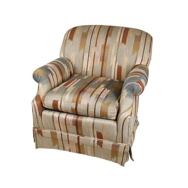 A beautifully upholstered armchair by Baker Furniture Company. This classic Baker chair is upholstered in a thick ikat or...