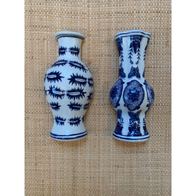 Great pair of Chinoiserie blue and white porcelain wall pockets. Two different designs - one has a rounded front, the...