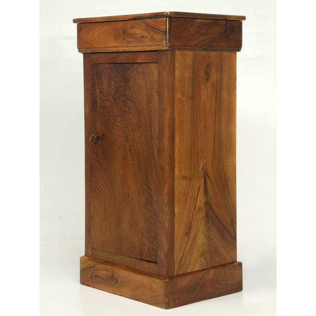 Antique French Louis Philippe style nightstand in a beautiful walnut that we just completed French polishing. Single...