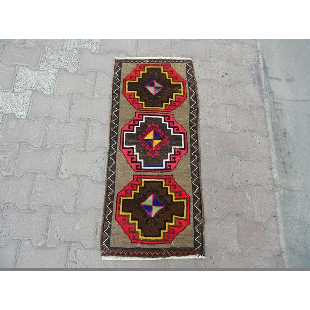 Handknotted vintage rug from kars region of turkey. Approximately 45-55 years old.In very good condition.