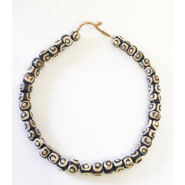 Superb String of African handmade trade bone brown and white beads strung on hemp. For layering in decor or wearing....