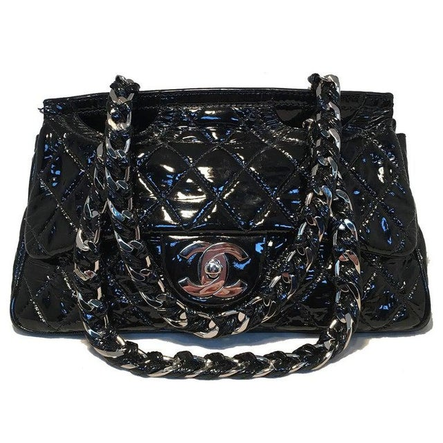 Chanel Black Patent Leather 2 way Classic Flap Shoulder Bag in very good condition. Black quilted patent leather exterior...