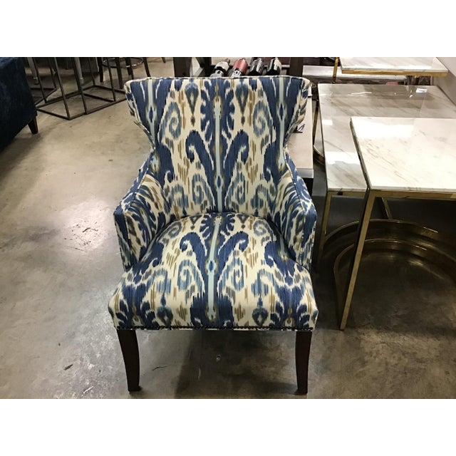 This transitional chair has the comfort of a wing chair and styling for modern living. The softly curved back is contoured...