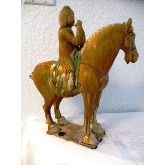 Large vintage ceramic pottery tang-design stallion with rider and green drip glaze finish on saddle. Felt underside for...