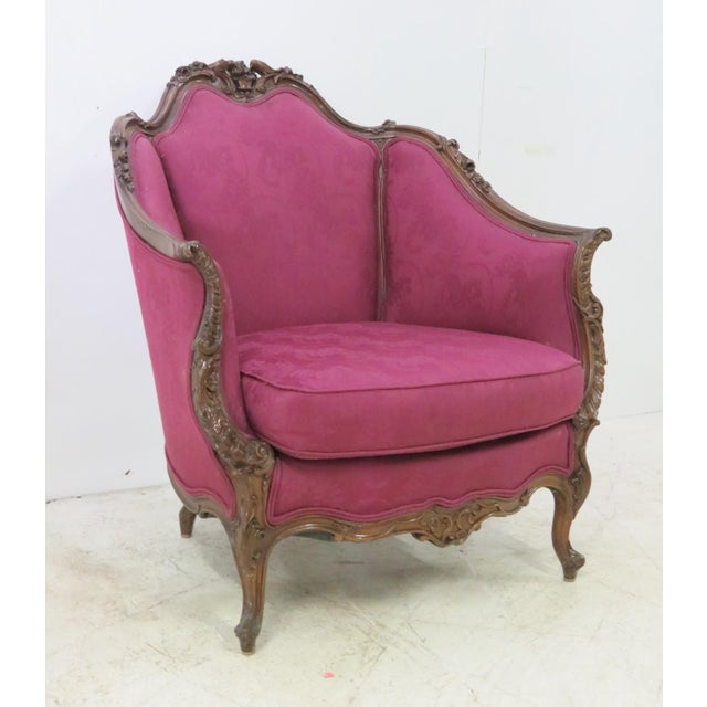 Early 20th century French style club chair with all over carved frame , love birds in crest