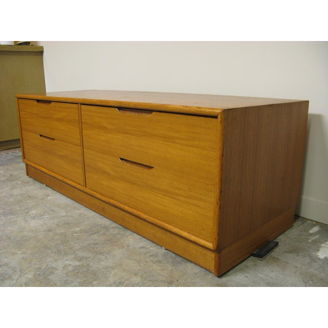 Danish teak media cabinet. Unknown maker. Great lines and a unique piece. I believe this was originally a very large TV...