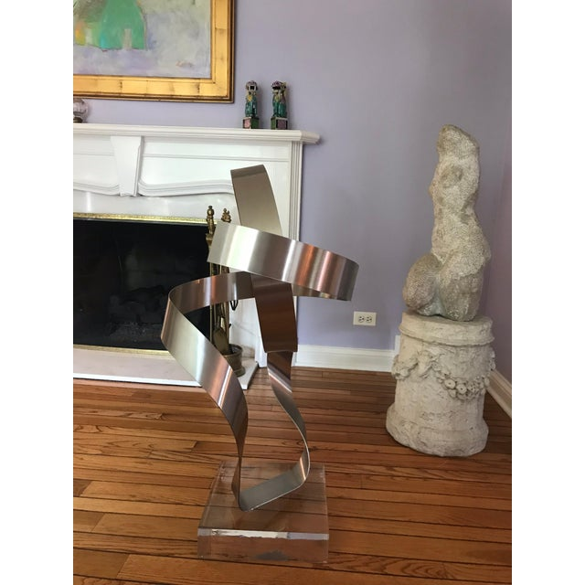 This is the first out of 25 of these extra large abstract metal sculptures made in 1978 by Dan Murphy It is mounted on a...