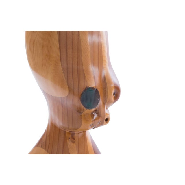 Alien head sculpture circa mid-1970s. This large-scale example combines layered walnut and birch and has resin accents.