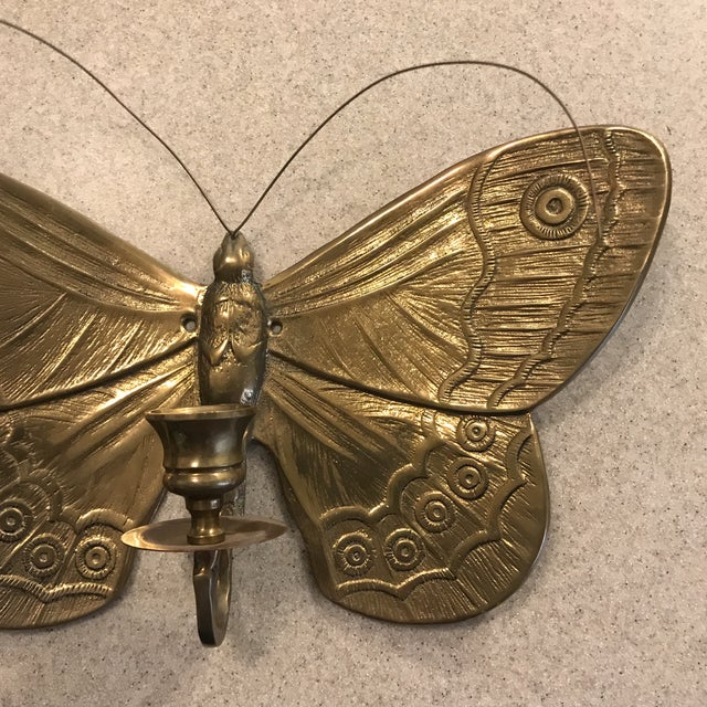 """Beautiful solid brass butterfly candle holder that mounts to the wall. Measures 12.5"""" wide x 8.25"""" tall and projects from..."""
