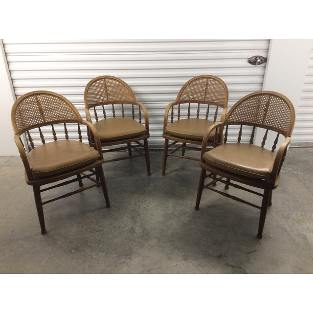 Impeccable antique Captains Chairs with cane cracks. Often referred to as firehouses Chairs Faux leather seat cushions....