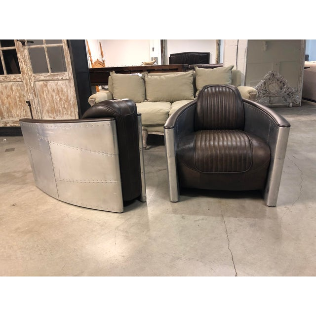 Design Plus Gallery presents a pair of Aviator Chairs by Restoration Hardware. Inspired by World War II fighter planes,...