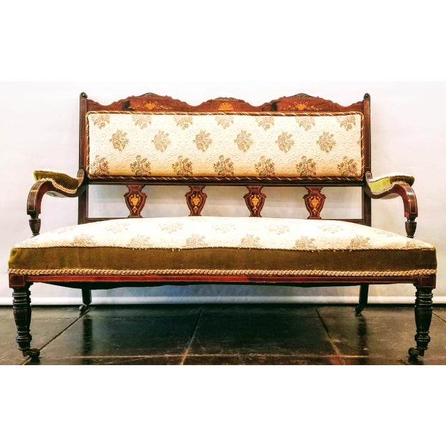 Edwardian era (1901-1909) settee would most likely have been accompanied by the rest of a salon suite that may have...