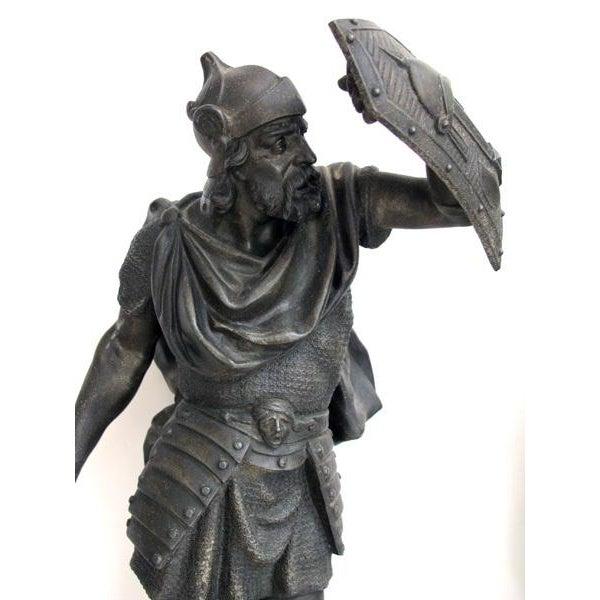 A well-executed pair of English spelter figures of visigoth warriors; each warrior engaged in battle with shields and...