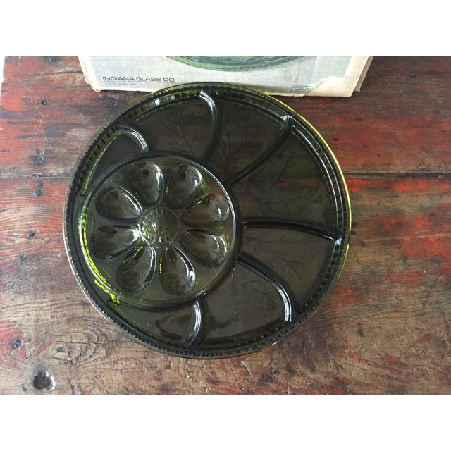 Deep green glass divided appetizer tray in original box.