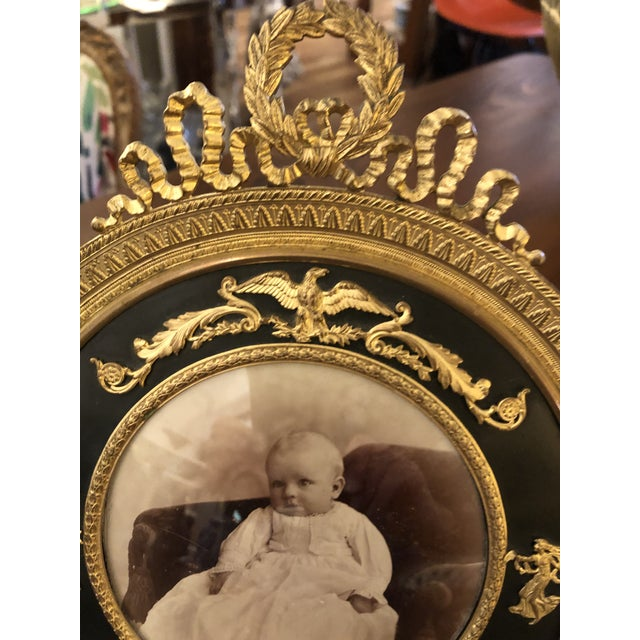 Perhaps the prettiest photo frame ever. French Empire antique gilt and patinated bronze frame having incredible details...