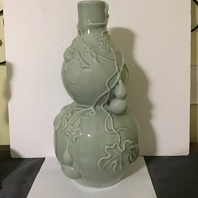 Chinese Asian celadon jade style color vase. Highly detailed porcelain.