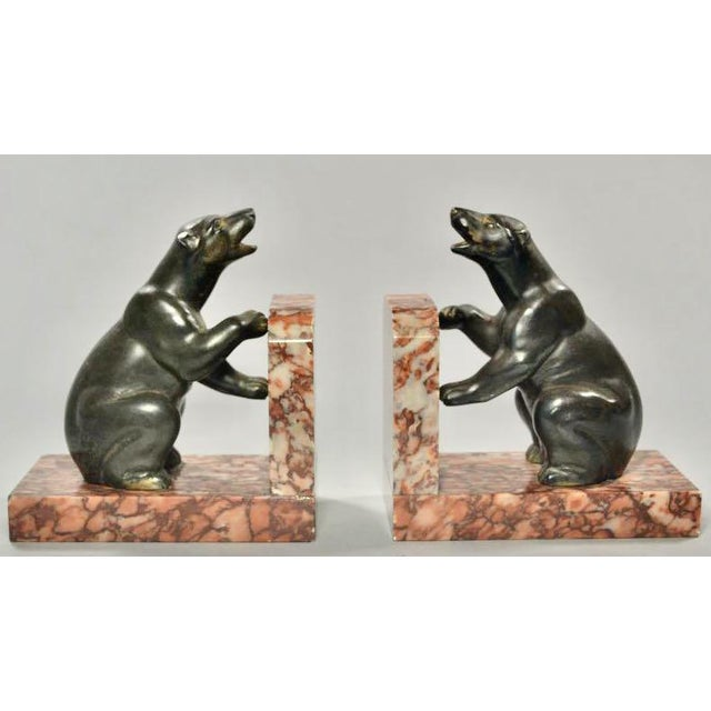 French Art Deco Polar Bear Bookends. Circa 1930s unsigned metal bear sculptures on a red marble base. Smiling polar bears...