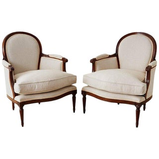 Pair of French Louis XVI Style Walnut Bergeres For Sale