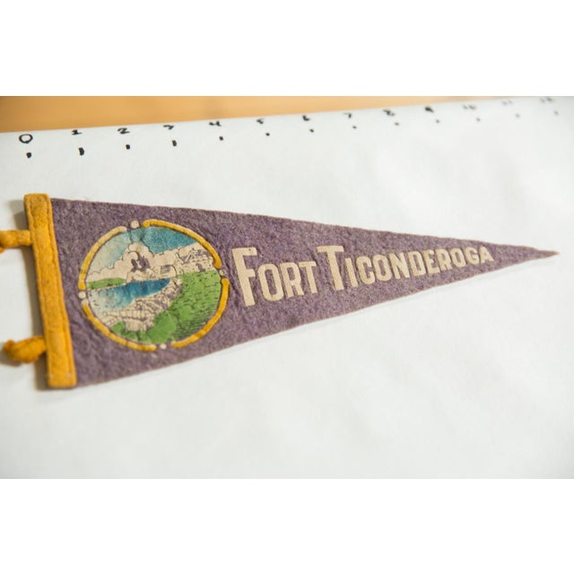 :: Vintage circa 1940's souvenir felt flag banner pennant from Fort Ticonderoga in New York. Features a circular image in...