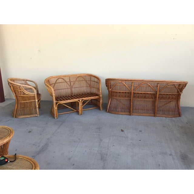 Beautiful curvy hourglass bamboo set. Includes a three seat sofa, two seat loveseat, chair, small side table, oval coffee...