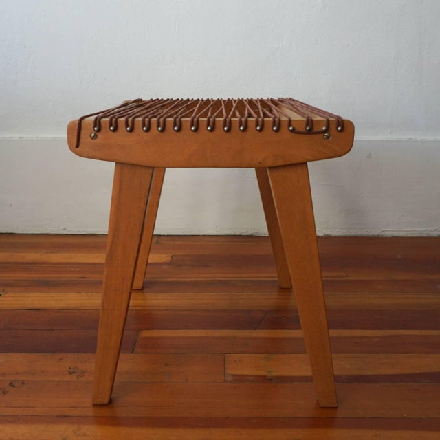 Wood and string stool by Robert J Ellenberger for Calfab Furniture Company, Los Angeles California. This design was...