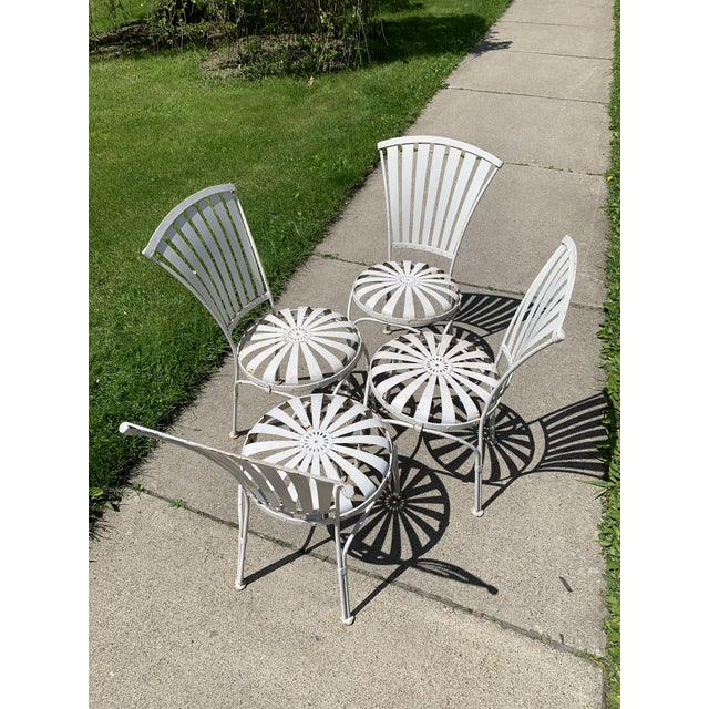 Set of 4 French sunburst bouncy chairs by Francois Carre. These highly sought after chairs have a great design and...