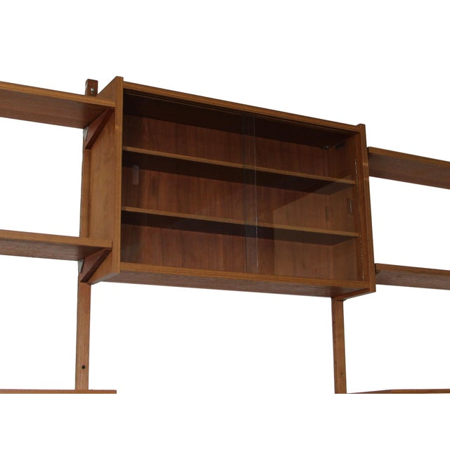 This is a stunning mid century 7 bay teak shelving unit by PS System. Made in Denmark. Similar to Cadovius units. It is a...