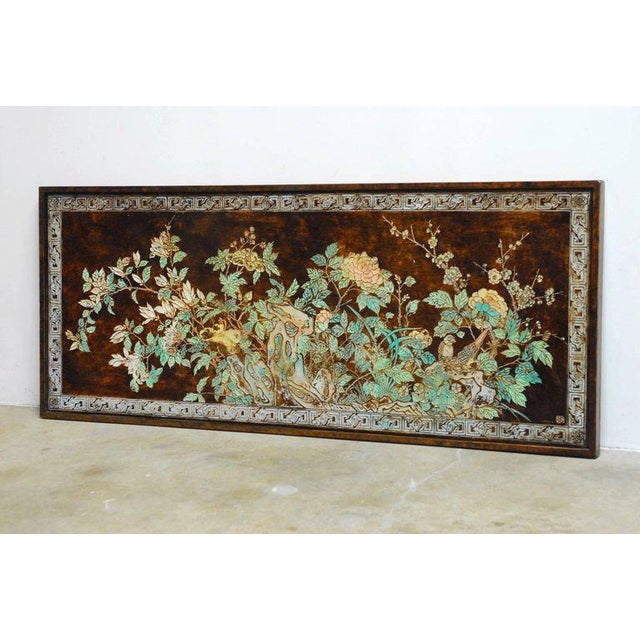 Colorful Chinese floral and foliate painted relief panel. Features an abundance or verte colored leaves with flowers and...