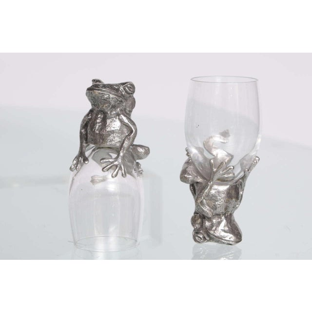 Intricately crafted crystal glassware (champagne, wine, aperitif) depicting giraffes, frogs and cheetahs in pewter. 26...